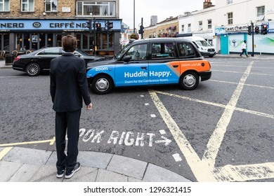 London, UK - September 12, 2018: Neighborhood of Pimlico with road and cafe Nero restaurant and one business man waiting to cross street with taxi cab car