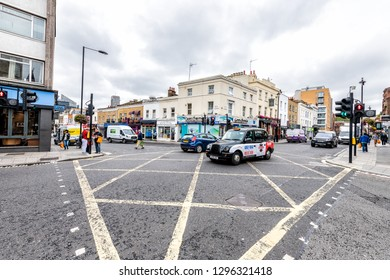 London, UK - September 12, 2018: Neighborhood of Pimlico with busy street road and cars in traffic during cloudy day