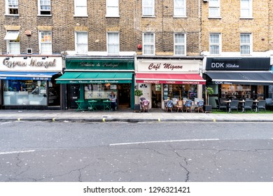 London, UK - September 12, 2018: Neighborhood of Pimlico Street with empty road and vintage old stores shops cafe restaurants with nobody