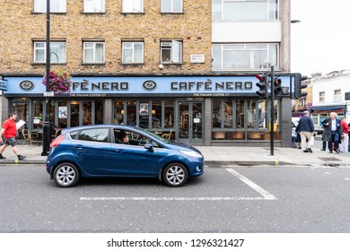 London, UK - September 12, 2018: Neighborhood of Pimlico Street with road and cafe Nero restaurant with people and car