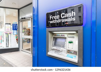 London, UK - September 12, 2018: Blue bank free cash sign atm at banking branch or store shop building entrance in Pimlico Victoria