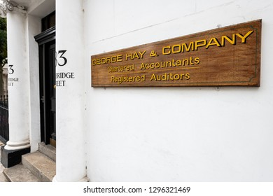 London, UK - September 12, 2018: Neighborhood of Pimlico on Cambridge street with historic architecture and closeup of sign for George Hay and Company Accountants