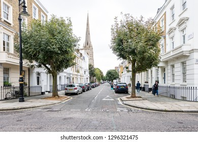 London, UK - September 12, 2018: Neighborhood district of Pimlico empty street alley with historic architecture and church