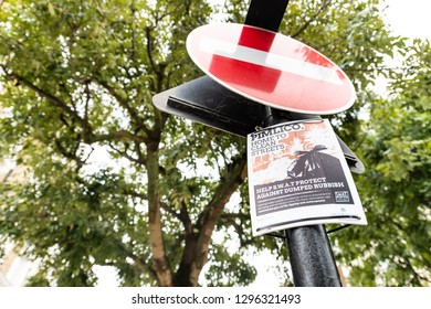 London, UK - September 12, 2018: Closeup of red stop sign in neighborhood district of Pimlico street road low angle looking up with text poster for clean rubbish