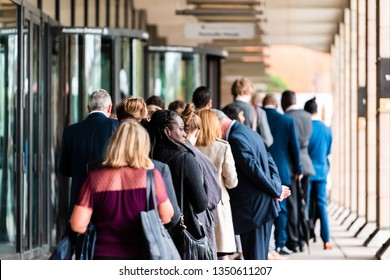 London, UK - September 12, 2018: People many crowd crowded standing in line queue to Westminster station cafe restaurant building on commute