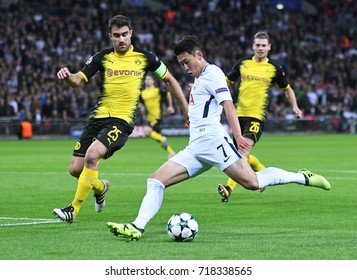 LONDON, UK - SEPTEMBER 13, 2017: Sokratis Papastathopoulos and Heung-Min Son pictured during the UEFA Champions League Group H game between Tottenham Hotspur and Borussia Dortmund at Wembley Stadium.