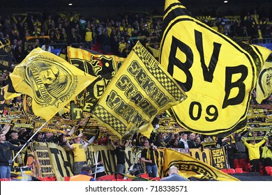 LONDON, UK - SEPTEMBER 13, 2017: Borussia fans pictured with flags during the UEFA Champions League Group H game between Tottenham Hotspur and Borussia Dortmund at Wembley Stadium.