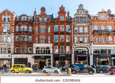 London, UK - September 13, 2018: Neighborhood district of Knightsbridge brick architecture, road, cars in street traffic on sunny day