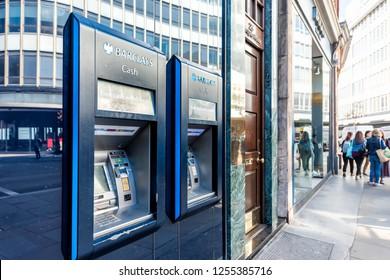 London, UK - September 13, 2018: Blue Barclays bank cash sign atm, banking branch, office building entrance in Chelsea, sidewalk