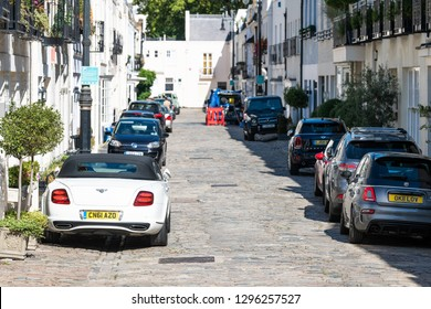 London, UK - September 13, 2018: Neighborhood district Kensington or Pimlico Victoria Chelsea private mews alley road on street with parked cars