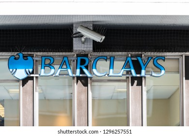 London, UK - September 13, 2018: Blue Barclays bank sign closeup with security camera and nobody in Knightsbridge Chelsea area