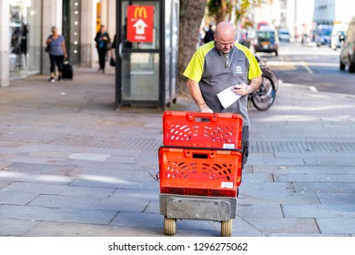 London, UK - September 13, 2018: Ocado online store grocery shopping delivery supermarket with man and baskets in Chelsea