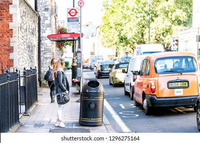 London, UK - September 13, 2018: Street sidewalk in Pimlico area by bus stop and many cars in traffic on road during sunny day