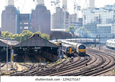 London, UK - September 13, 2018: Railroad transport pollution tracks in United Kingdom Pimlico area with cityscape of urban pipes smoke stacks in Battersea Power Plant