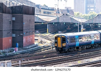 London, UK - September 13, 2018: Industrial railroad transport in United Kingdom Pimlico area with closeup of train on tracks