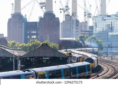 London, UK - September 13, 2018: Industrial railroad transport tracks in United Kingdom Pimlico area with cityscape of urban pipes smoke stacks in Battersea Power Plant