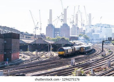 London, UK - September 13, 2018: Industrial railroad transport tracks in United Kingdom Pimlico area with cityscape skyline of urban pipes in Battersea Power Plant