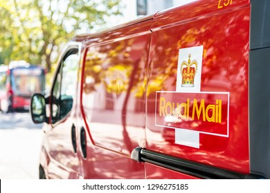 London, UK - September 13, 2018: Red Royal Mail delivery van truck car on street road in city in Pimlico