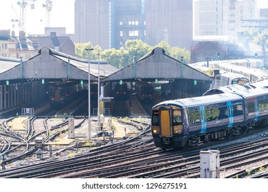 London, UK - September 13, 2018: Industrial railroad transport tracks in United Kingdom Pimlico area with closeup of train