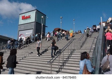 LONDON, UK- SEPTEMBER 13: Shoppers on the steps to the opening of Westfield Stratford City, the largest urban shopping centre in Europe, and gateway to the Olympic Park. September 13, 2011 London UK