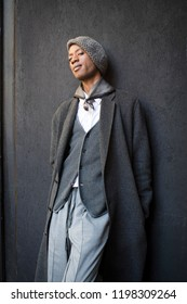 LONDON, UK- SEPTEMBER 14 2018: People on the street during the London Fashion Week. A man in a gray coat of wool flannel, trousers, vest and beret