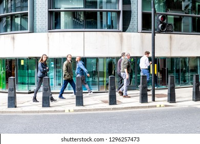London, UK - September 14, 2018: Neighborhood district of Victoria of Pimlico with building and many people pedestrians walking home from work commuting