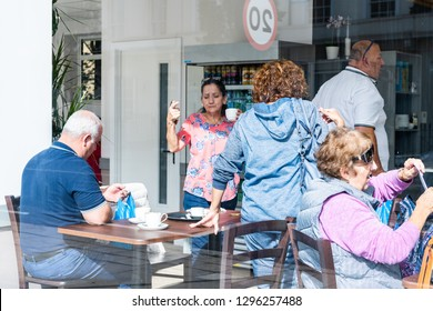 London, UK - September 14, 2018: Pimlico local Neighborhood district cafe with people sitting at table eating breakfast drinking coffee inside interior family