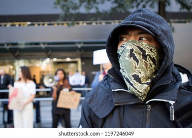 "LONDON UK SEPTEMBER 14TH 2018, London Fashion Week PETA demonstrators in cat outfits celebrate a ""No Fur"" fashion week, man in a hood with a blindfolded face"
