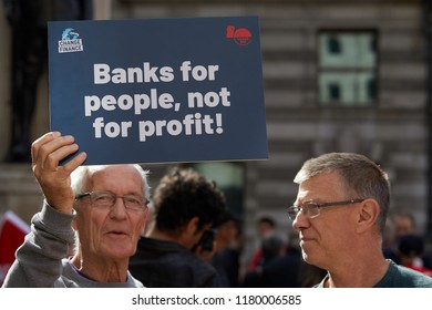 London, UK. - September 15 2018: A placard held up by a protestor at the Change Finance rally outside the Royal Exchange London to protest a decade since banks were bailed out.