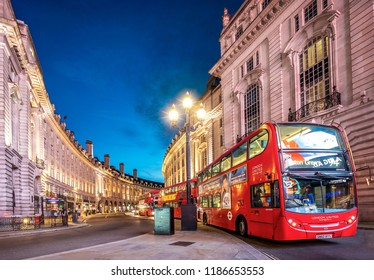 LONDON, UK - SEPTEMBER 15, 2018: The historic architecture of London in the United Kingdom showcasing Regent Street at night with the traditional double deck red bus passing by.