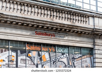 London, UK - September 15, 2018: Neighborhood local store Sainsbury's local sign grocery shopping storefront facade exterior entrance with nobody