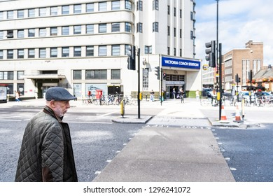 London, UK - September 15, 2018: United Kingdom Pimlico Westminster district with man standing at crosswalk near Victoria station on urban street road