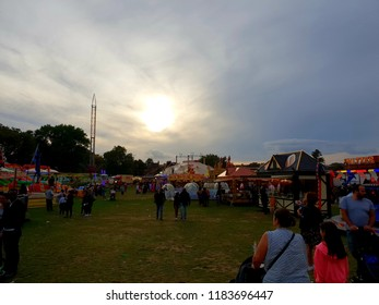 London, UK, September 15th 2018: people explorer and enjoying the amusement park in Peckham rye park in South London during sunset