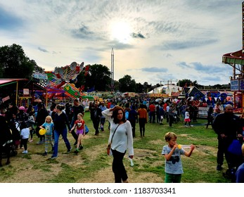 London, UK, September 15th 2018: people enjoying the amusement park rides at peckham rye park in South London