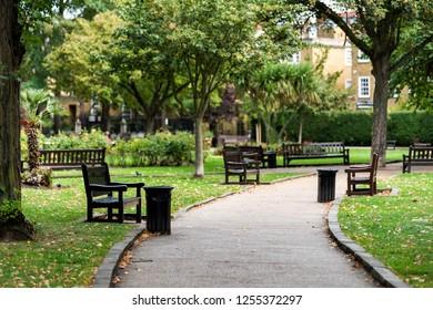 London, UK - September 16, 2018: Empty path in green St Luke's Gardens Park in Chelsea, landscape view during green autumn in United Kingdom, nobody