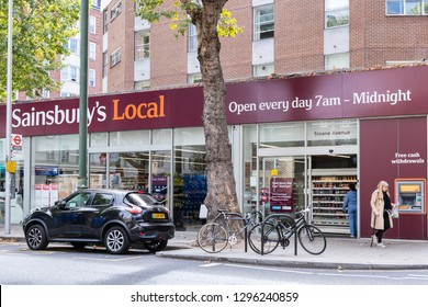 London, UK - September 16, 2018: Neighborhood store Sainsbury's local sign grocery shopping storefront facade exterior entrance with people in Chelsea Sloane avenue