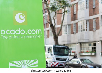 London, UK - September 16, 2018: Ocado online store grocery shopping delivery supermarket green sign on truck closeup in South Kensington