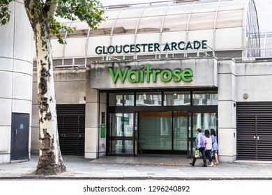 London, UK - September 16, 2018: Waitrose store grocery shopping facade exterior entrance with people at Gloucester Arcade Road in Kensington