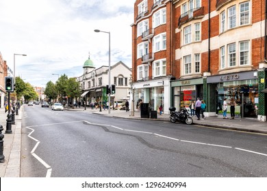 London, UK - September 16, 2018: Neighborhood district of Chelsea with brick architecture shopping stores on King's road street and church