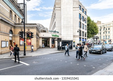 London, UK - September 16, 2018: Waitrose store grocery shopping facade exterior entrance with people crossing Gloucester Road in Kensington