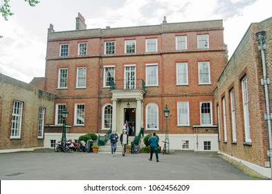 LONDON, UK - SEPTEMBER 17, 2017: Visitors at the entrance to the historic Bushy House, part of the National Physical Laboratory, on an open day in September.