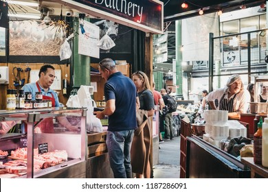 London, UK - September 17, 2018: People buying mean from Northfield Butchery shop at Borough Market, one of the largest and oldest food markets in London.