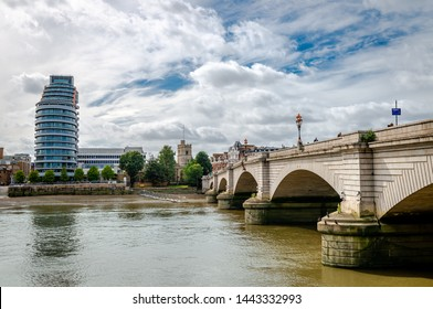 London / UK - September 18 2018: View of the Putney bridge with The St Mary's Church and the Putney Wharf Tower in the backgound.
