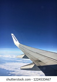 London, UK - September 19 2018:  The wing of a Ryanair Boeing 737 aircraft taken from within the aircraft