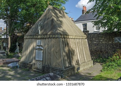 LONDON, UK - SEPTEMBER 20, 2015: Tent shaped tomb of the renowned Victorian explorer Sir Richard Burton in the churchyard of St Mary Magdalen Mortlake, West London.  Constructed 1890.