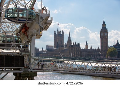 LONDON, UK - SEPTEMBER 20, 2015: Centre of London view from the Thames embankment. Big Ben, Parliament and London eye