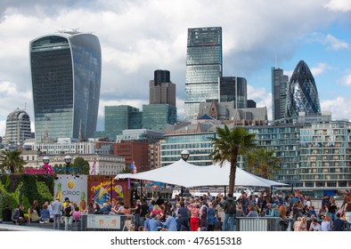 LONDON, UK - SEPTEMBER 20, 2015: Cafe at the Thames embankment with people and tourists resting and refreshing