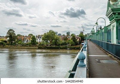 London / UK - September 20 2018: View of the Fulham Railway bridge, that spans river Thames, from the north. Putney is in the background.