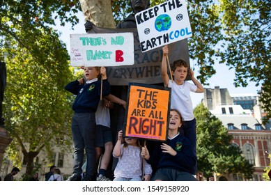 London, UK - September 20 2019: Global climate strike protesters outside Parliament. Millions of  students around the world are taking part in the climate strike to demand governments take action.