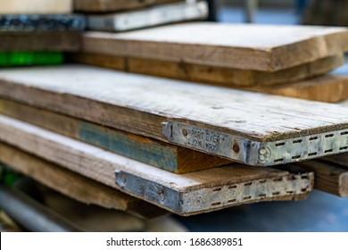 LONDON, UK - September 20, 2019: Wooden scaffolding boards in a pile about to be used on a building site.